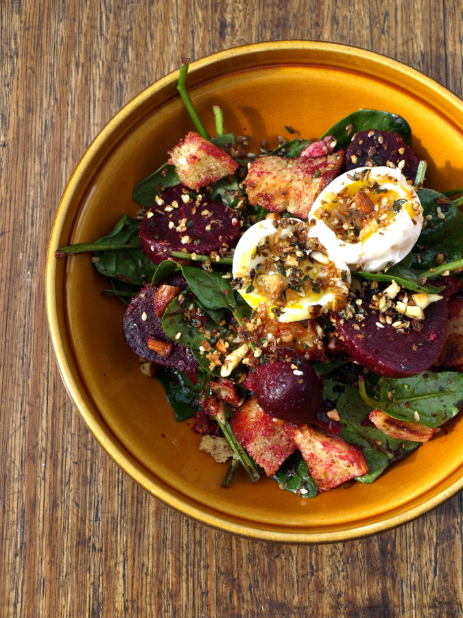 Beetroot salad with spinach, egg and dukkah croutons
