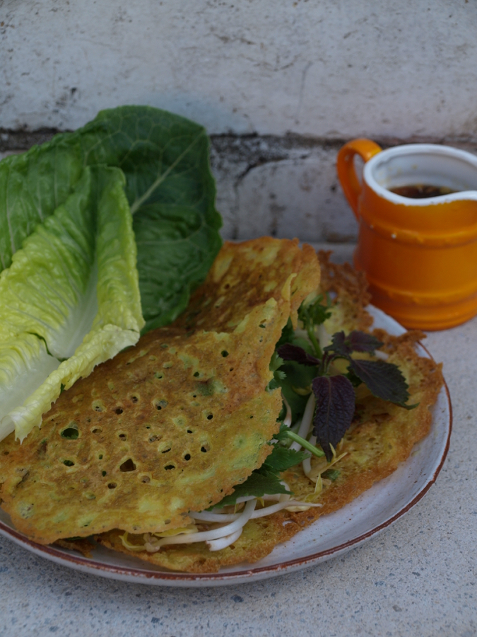 Vietnamese pancakes with bean sprouts, herbs and lettuce